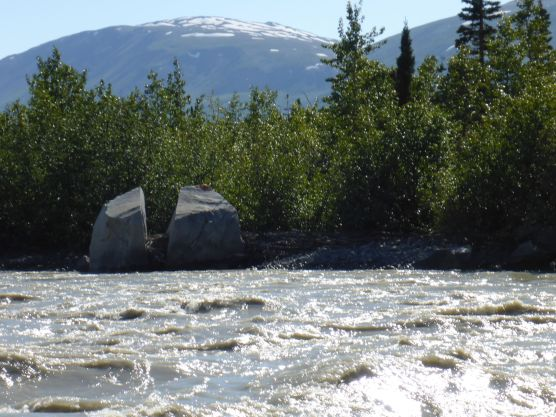 Erratics (stones left by glaciers) beside river